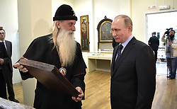 May 31, 2017 - Moscow, Russia - May 31, 2017. - Russia, Moscow. - Russian President Vladimir Putin reviews the exhibition of monuments of culture of the old-rite church of the 16th-20th centuries 'The Power of Spirit and Loyalty to Tradition' at the Church of the Nativity of the Rogozhskaya Zastava Spiritual Center of the Russian Orthodox Old-Rite Church. Head of the Russian Orthodox Old-Rite Church, Metropolitan Kornily, left. (Credit Image: © Russian Look via ZUMA Wire)