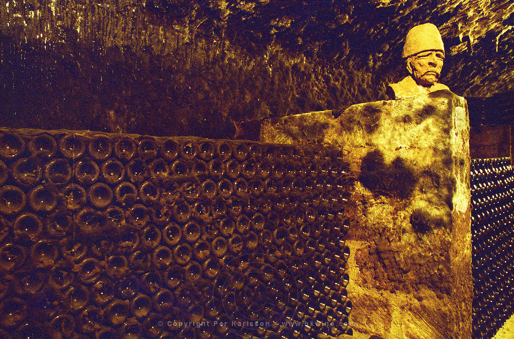 The Thummerer winery in Eger: in the cellar (carved in the rock) there are sculptured heads, giving the cellar a mystical mood, and of course many bottles with aging wine. Thummerer is one of the leading growers and wine makers in Eger. Credit Per Karlsson BKWine.com
