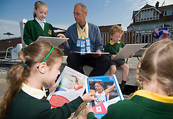 © Licensed to London News Pictures. Henley-on-Thames, UK  03/10/2011. Sir Steve Redgrave talks to schoolchildren from Valley road primary school in Henley-on-Thames about how to be an Olympic champion on the bank of the River Thames, Oxfordshire. Sir Steve Redgrave was launching the new Top Trumps Tournament Olympic game. Photo credit: LNP