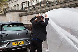 Sylvie Childs, Senior Product Manager at Hyundai UK breathes the air from a balloon fed by the exhaust as Hyundai UK demonstrates the Hydrogen-powered Nexo that not only produces completely clean emissions but also cleans up the air its engine ingests, thanks to a filtration system developed by scientists at University College London. UCL London, October 17 2018.