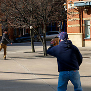"""Gabriel Huth, left, and his father, Jerry Huth, both of Toledo, throw a baseball outside Fifth Third Field in Toledo on Thursday, April 16, 2020. Today would have been the opening day for the Mud Hens had COVID-19 not postponed the start of the Minor League Baseball season. """"We were at the first opening game downtown, and then I don't think we've missed one since,"""" Jerry said.  THE BLADE/KURT STEISS"""