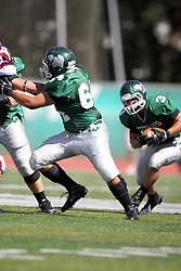 08 September 2012:  T.J. Stinde works off a block by Alex Bell during an NCAA division 3 football game between the Alma Scots and the Illinois Wesleyan Titans which the Titans won 53 - 7 in Tucci Stadium on Wilder Field, Bloomington IL