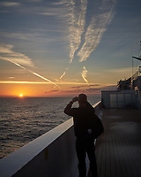 Jet Contrails over the North Atlantic Ocean from the Deck of MV Explorer. Image taken with a Leica X2 camera (ISO 100, 24 mm, f/8, 1/250 sec).