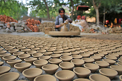 November 2, 2018 - Jaipur, Rajasthan, India - An Indian potter makes earthen lamps  ahead the Diwali festival in Jaipur,Rajasthan , India,  Nov 02 ,2018. People buy earthen lamps to decorate their homes during Diwali, the annual Hindu festival of lights which will be celebrated on Nov 07,2018. (Credit Image: © Vishal Bhatnagar/NurPhoto via ZUMA Press)