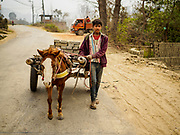 09 MARCH 2017 - BAGMATI, NEPAL: Workers use pony carts to haul unbaked bricks to a kiln at a brick factory in Bagmati, near Bhaktapur. There are almost 50 brick factories in the valley near Bagmati. The brick makers are very busy making bricks for the reconstruction of Kathmandu, Bhaktapur and other cities in the Kathmandu valley that were badly damaged by the 2015 Nepal Earthquake. The brick factories have been in the Bagmati area for centuries because the local clay is a popular raw material for the bricks. Most of the workers in the brick factories are migrant workers from southern Nepal.           PHOTO BY JACK KURTZ