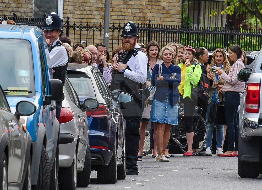 © Licensed to London News Pictures. 07/09/2017. London, UK. Member son the public and police gather at Thomas's Battersea in south London where PRINCE GEORGE started his first day at school today. Photo credit: Ben Cawthra/LNP