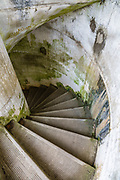 A concrete spiral stairwell at Battery Russell in Fort Stevens State Park, on the Oregon coast, USA. Fort Stevens operated from 1863–1947 as part of a three-fort American military system defending the Columbia River Mouth. Built near the end of the American Civil War, this American military installation was named for a slain Civil War general and former Washington Territory governor, Isaac I. Stevens. In June 1942 during World War II, a Japanese submarine fired 17 rounds upon Fort Stevens (luckily causing causing no real damage), making it the only military base on the Continental United States to be fired upon by an enemy since the War of 1812.