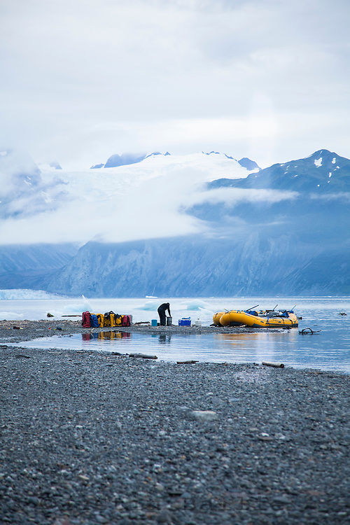 """Loading boats on Alsek Lake while on a  raft trip down the Tashenshini River. The """"Tat"""" flows out of Yukon, CA, through British Columbia and empties into Glacier Bay National Park in Alaska, US."""