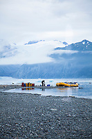 "Loading boats on Alsek Lake while on a  raft trip down the Tashenshini River. The ""Tat"" flows out of Yukon, CA, through British Columbia and empties into Glacier Bay National Park in Alaska, US."