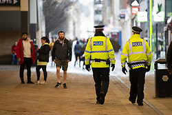 © Licensed to London News Pictures. 28/11/2020. Manchester, UK. Police walk along Market Street, Manchester. Manchester will enter Tier 3. Photo credit: Kerry Elsworth/LNP