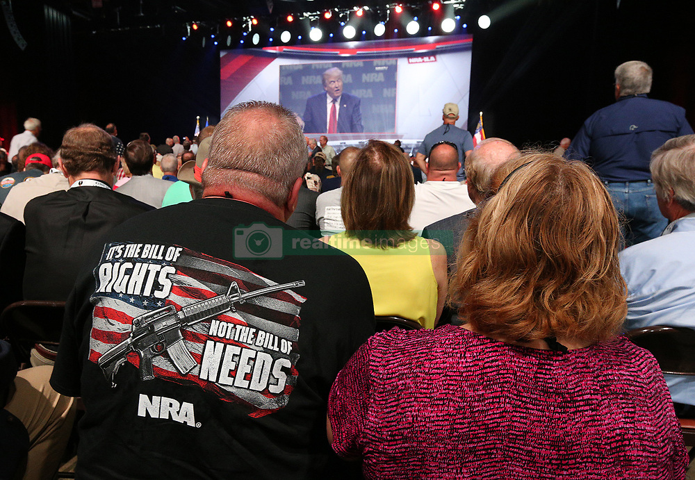 April 28, 2017 - Atlanta, GA, USA - NRA attendees Bill and Karen Geittman watch a video of President Donald Trump while waiting for him to arrive for a keynote at the NRA-ILA Leadership Forum on Friday, April 28, 2017, in Atlanta. (Credit Image: © Curtis Compton/TNS via ZUMA Wire)