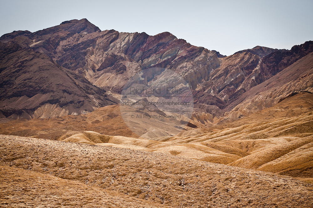 Contrasting sediment badlands at Zabriskie Point looking toward Golden Canyon in Death Valley National Park, Nevada, USA. Zabriskie point was once the home of twenty-mule team borax mines.