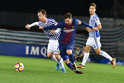 January 14, 2018 - San Sebastian, Guipuzcoa, Spain - Zurutuza of Real Sociedad duels for the ball with Lionel Messi of Barcelona during the Spanish league football match between Real Sociedad and Barcelona at the Anoeta Stadium on 14 January 2018 in San Sebastian, Spain  (Credit Image: © Jose Ignacio Unanue/NurPhoto via ZUMA Press)