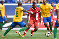 July 7, 2017 - Harrison, New Jersey, U.S - Canada midfielder JUNIOR HOILETT (10) in action during the CONCACAF Gold Cup 2017 at Red Bull Arena in Harrison New Jersey Canada defeats French Guiana 4 to 2. (Credit Image: © Brooks Von Arx via ZUMA Wire)