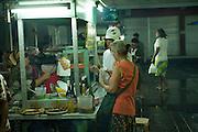 Anne and Yujiro choosing food at the Pasar Malam (night market). Sanur, Bali
