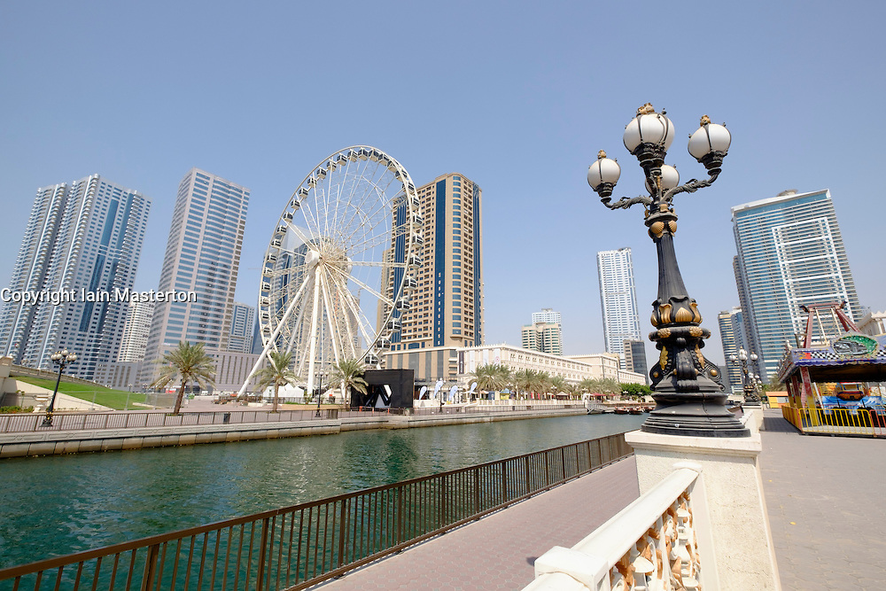 View of Eye of the Emirates ferris wheel and Al Qasba entertainment district in Sharjah United Arab Emirates