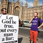 A man makes fun of the religious protester. A few Christians opponents of the bill made themselves hear using a speaker and posters. They threatened the crowd with God's ponishment for being sinners. The moment when it is announced that the Same Sex Marriage bill had been passed. London Gay Chorus and supporters of the bill celebrate outside the House of Lords. The campaign for the bill has lasted decades. Summary of the Marriage (Same Sex Couples) Bill 2012-13 to 2013-14<br /> A Bill to make provision for the marriage of same sex couples in England and Wales, about gender change by married persons and civil partners, about consular functions in relation to marriage, for the marriage of armed forces personnel overseas, and for connected purposes.
