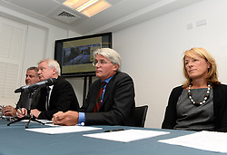 Former chief whip Andrew Mitchell (second from right) speaks to press in Farringdon to give his reaction on the Crown Prosecution Service's decision on the 'Plebgate' row, accompanied by his wife, Dr Sharon Bennett (right), David Davies MP and Stephen Parkinson (third from right). Tuesday, 26th November 2013. Picture by Ben Stevens / i-Images