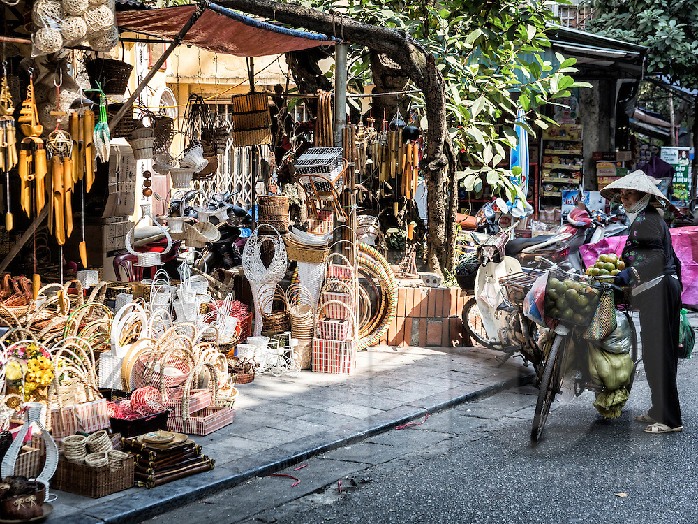 Shop overflowing with wicker products along Ngo Gach 'wicker goods street' in Hanoi's Old Quarter, Vietnam, Southeast Asia