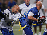 Mike Furrey (left) has Ricky Proehl by the jersey, and partially has his flag pulled off in this first quarter play. Proehl received a pass from Kurt Warner and took off for a short gain downfield -- and Furrey had a grip on him the whole way.