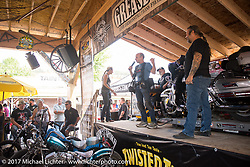 Michael Lichter speaking on the Grease and Gears Garage stage at the Broken Spoke on the Iron Horse Saloon lot during the annual Sturgis Black Hills Motorcycle Rally.  SD, USA.  August 9, 2017.  Photography ©2017 Michael Lichter.