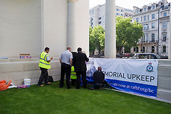"""© London News Pictures. 05/06/2013. London, UK. Repair work being carried out on the The RAF Bomber Command Memorial in London's Green Park which has been vandalised for a second time. Last week the word """"Islam"""" was sprayed onto the memorial in the aftermath of the killing of Drummer Lee Rigby in Woolwich.. Photo credit: Ben Cawthra/LNP"""