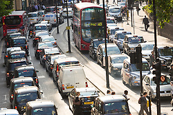 © Licensed to London News Pictures. 08/07/2015. London, UK. Grid lock traffic jam on London Wall in the City of London this evening. London transport workers begin strike action tonight, which will continue tomorrow. Photo credit : Vickie Flores/LNP