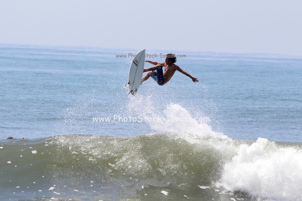 Surfing the waved of the Pacific ocen. Photographed in El Tunco, El Salvador