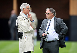 Trainer Hughie Morrison (left) speaks to an on course vet in the pre-parade ring during day two of the Dante Festival at York Racecourse.