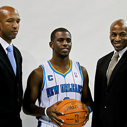 Sep 27, 2010; New Orleans, LA, USA; New Orleans Hornets head coach Monty Williams (left) poses with Chris Paul (center) and general manager Dell Demps (left) during media day at the New Orleans Arena. Mandatory Credit: Derick E. Hingle