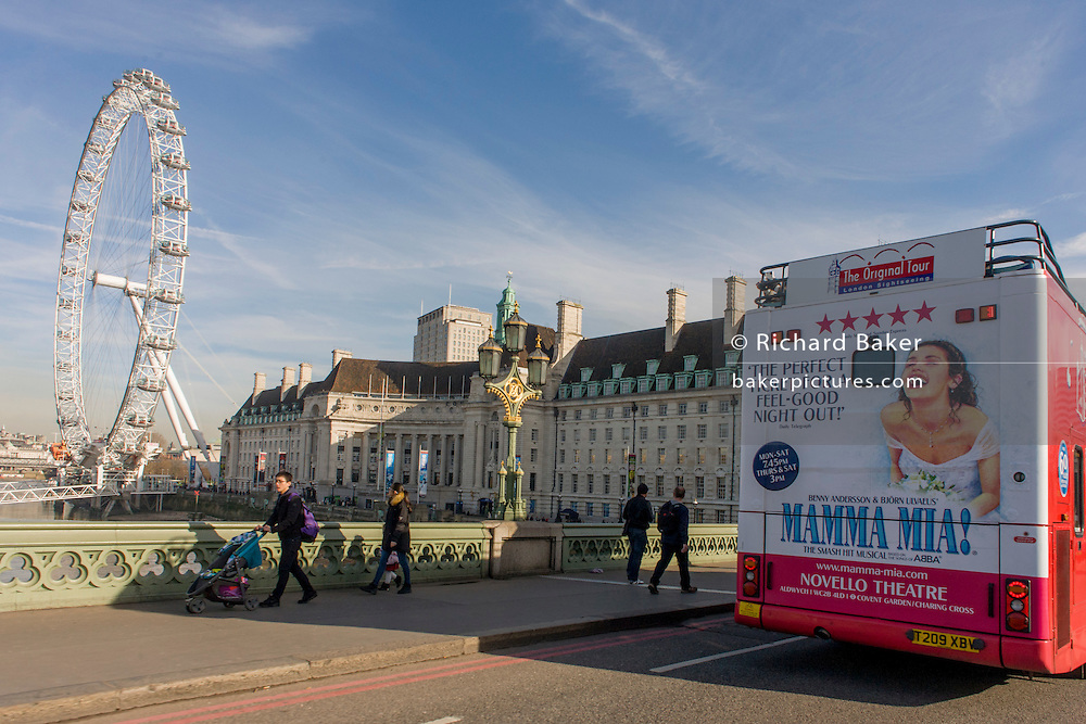 Bus rear advertising for Abba's West End musical Mamma Mia as it drives southbound over Westminster  Bridge and the London Eye.