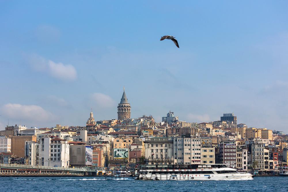 Skyline cityscape of Karakoy, Galata Tower and Beyoglu with ferry boat on Bosphorus River, Istanbul, Republic of Turkey