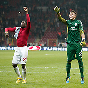 Galatasaray's goalkeeper Nestor Fernando Muslera (R) and Emmanuel Eboue (L) celebrate victory during their Turkish Super League soccer match Galatasaray between Manisaspor at the TT Arena at Seyrantepe in Istanbul Turkey on Wednesday, 21 December 2011. Photo by TURKPIX
