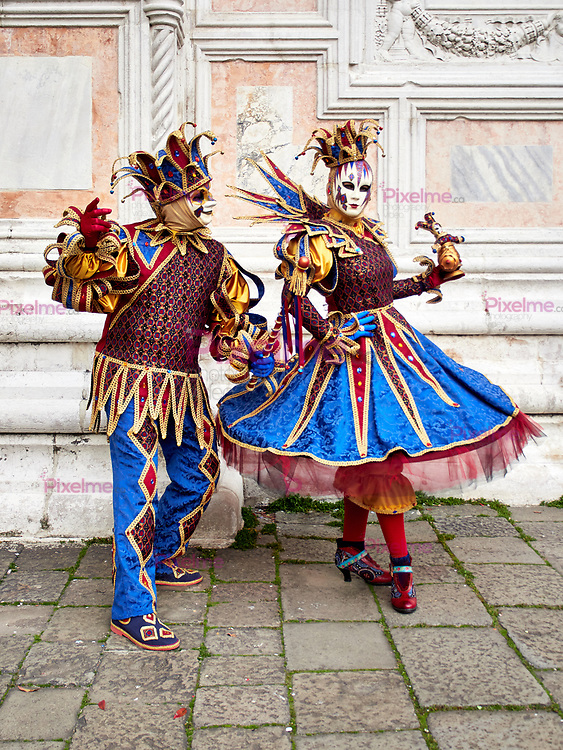 Venice, Italy - March 1, 2019 A couple is dressed with an Arlequin costume during the Carnival of Venice