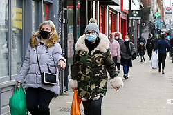 © Licensed to London News Pictures. 06/01/2021. London, UK. Shoppers wearing protective face coverings in north London. The Met Police have warned that members of public who break coronavirus lockdown restrictions by refusing to wear a mask 'can expect to be fined'.  Prime Minister Boris Johnson announced on Monday 4 January 2021 that England will go into third national lockdown after the mutated variant of the SARS-Cov-2 virus continues to spread around the country, and asked everyone to 'stay at home' and only leave for the specific reasons, until mid-February. Photo credit: Dinendra Haria/LNP