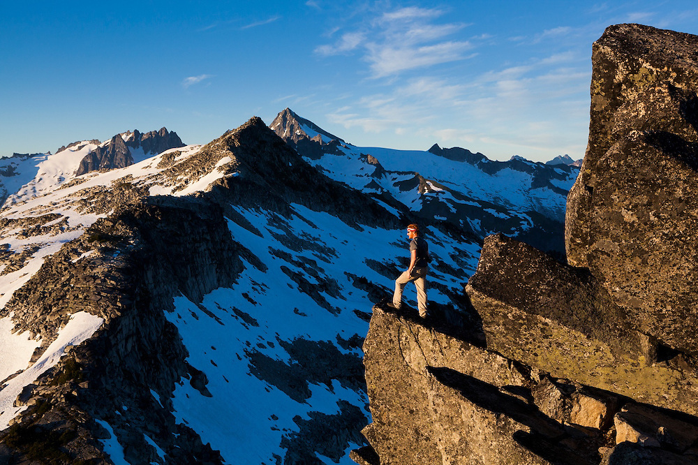 Stephen Byrne looks down into the Cascade River drainage from the summit of Hidden Lake Peaks, North Cascades National Park, Washington.