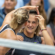 2019 US Open Tennis Tournament- Day Fourteen.  Elise Mertens of Belgium and Aryna Sabalenka of Belarus prepare their hair for the trophy presentation after their victory against Victoria  Azarenka of Belarus and Ashleigh Barty of Australia in the Women's Doubles Final on Arthur Ashe Stadium during the 2019 US Open Tennis Tournament at the USTA Billie Jean King National Tennis Center on September 8th, 2019 in Flushing, Queens, New York City.  (Photo by Tim Clayton/Corbis via Getty Images)