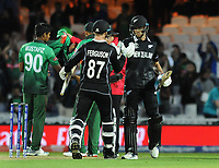 Cricket - 2019 ICC Cricket World Cup - Group Stage: Bangladesh vs. New Zealand<br /> <br /> Lockie Ferguson and Mitch Santner of NZ celebrate after winning the match, at Kia Oval.<br /> <br /> COLORSPORT/ANDREW COWIE