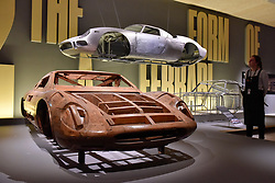 """© Licensed to London News Pictures. 14/11/2017. London, UK.  A wooden model for the Ferrari 365 P, 1966, by Pininfarina and an aluminium body shell for the Ferrari 250 LM, 1964. Preview of """"Ferrari: Under the Skin"""", an exhibition at the Design Museum to mark the 70th anniversary of Ferrari.  Over GBP140m worth of Ferraris are on display from private collections including Michael Schumacher's 2000 F1 winning car.  The exhibition runs 15 November to 15 April 2018.  Photo credit: Stephen Chung/LNP"""