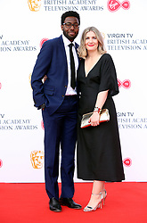 Daniel Lawrence Taylor and guest attending the Virgin TV British Academy Television Awards 2018 held at the Royal Festival Hall, Southbank Centre, London. PRESS ASSOCIATION Photo. Picture date: Sunday May 13, 2018. See PA story SHOWBIZ Bafta. Photo credit should read: Isabel Infantes/PA Wire