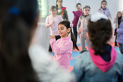 17 February 2020, Zarqa, Jordan: A girl takes the lead in showing an Indian dance during a Zumba session for children at the Lutheran World Federation community centre in Zarqa. Through a variety of activities, the Lutheran World Federation community centre in Zarqa serves to offer psychosocial support and strengthen social cohesion between Syrian, Iraqi and other refugees in Jordan and their host communities.