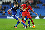 Cardiff City's Joe Ralls (l) challenges Blackburn Rovers Fode Koita. Skybet football league championship match, Cardiff city v Blackburn Rovers at the Cardiff city stadium in Cardiff, South Wales on Saturday 2nd Jan 2016.<br /> pic by Carl Robertson, Andrew Orchard sports photography.