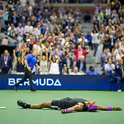 2019 US Open Tennis Tournament- Day Fourteen.   Rafael Nadal of Spain lfalls to the court as the line judge signal out to celebrate his five set win against Danill Medvedev of Russia in the Men's Singles Final on Arthur Ashe Stadium during the 2019 US Open Tennis Tournament at the USTA Billie Jean King National Tennis Center on September 8th, 2019 in Flushing, Queens, New York City.  (Photo by Tim Clayton/Corbis via Getty Images)