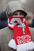 """Moscow, Russia, 15/01/2011..A man wears a Spartak scarf with the words """"Death To The Enemy"""" at a rally at the bus stop where Spartak soccer fan Yegor Sviridov was killed in a street fight with a group of men from the southern Caucasus, leading to a nationalist backlash that has spilled into racist violence on the streets of Moscow and other Russian cities. The rally on the 40th day after Sviridov's death was attended by a mixture of local people, football fans and Russian nationalists."""