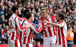 Stoke City's Xherdan Shaqiri (centre) celebrates scoring his side's first goal of the game with team-mates