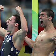 Garrett Weber-Gale and Michael Phelps of the United States celebrate finishing the Men's 4 x 100m Freestyle Relay Final in first place to win the gold medal held at the National Aquatics Center on Day 3 of the Beijing 2008 Olympic Games on August 11, 2008 in Beijing, China. The United States finished the race in first place in a time of 3:08.24 and wins the gold medal and set a new World Record. Photo Tim Clayton