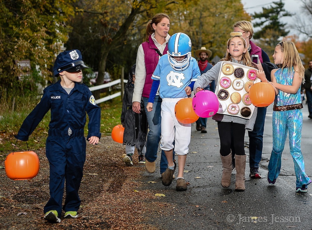 """(From left) Henry Young, 4, Jack Young, 8, Norah Kobaly, 9, and Maeve Young, 8, of Littleton, walk as a group during the Halloween """"Trunk or Treat"""" parade down King Street in Littleton, Sunday Oct. 25, 2015.   (Wicked Local Photo/James Jesson)."""
