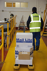 Man with a mild learning disability working as a factory cleaner, shown here delivering stationery, helped into employment by the Ready 4 Work team, Nottinghamshire County Council