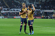 Santi Cazorla of Arsenal (19) appears to have a little disagreement with his teammate Calum Chambers. Barclays Premier league match, Swansea city v Arsenal  at the Liberty Stadium in Swansea, South Wales  on Saturday 31st October 2015.<br /> pic by  Andrew Orchard, Andrew Orchard sports photography.