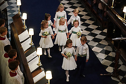 Bridesmaids and page boys walk down the aisle following the wedding of Princess Eugenie and Jack Brooksbank at St George's Chapel in Windsor Castle.